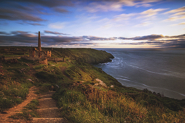 One of the filming locations of Poldark, a view of a walk in Cornwall leading to a ruin along a coastal path.